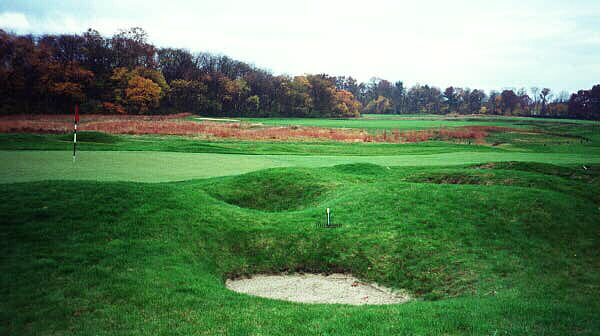 Traviss recently restored small mounds and bunkers make a recovery shot quite difficult on the 14th at Garden City.