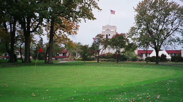 Many of the Tom Bendelows most interesting greens on the South Course are extensions of the fairway. Olympia Fields world famous clubhouse looms in the background.