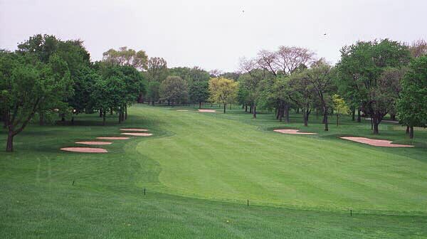 The tee shot on the 2nd hole at Beverly CC drops some 40 feet to the fairway below.