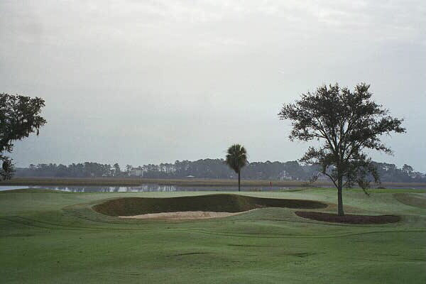 Though a reachable par five, the 16th green is heavily defended.
