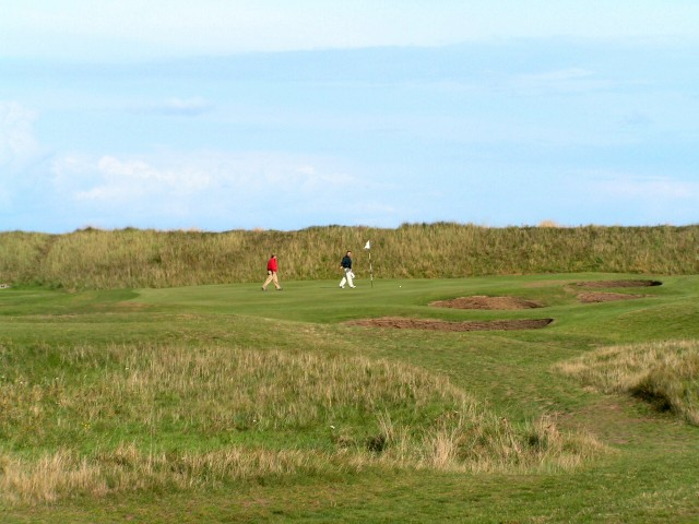 The seawall is the backdrop to the eighth green.