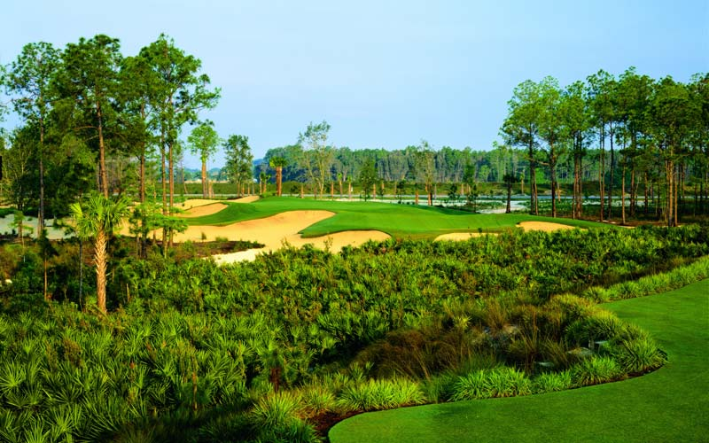 The beguiling par three third at Calusa Pines, whose short grass right poses as much challenge as the bunker left.