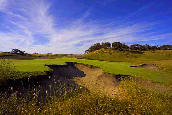 The seventeenth hole playing 468 metres, is prime example of the beautiful bunkers and green complexes found on the Gunnamatta course.