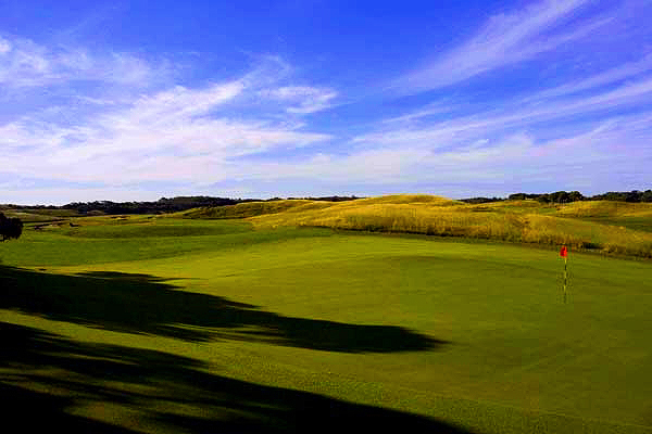 """Another bunkerless - and small """" green. Especially hard to hit from the lies liable on one of the fairway ridges."""