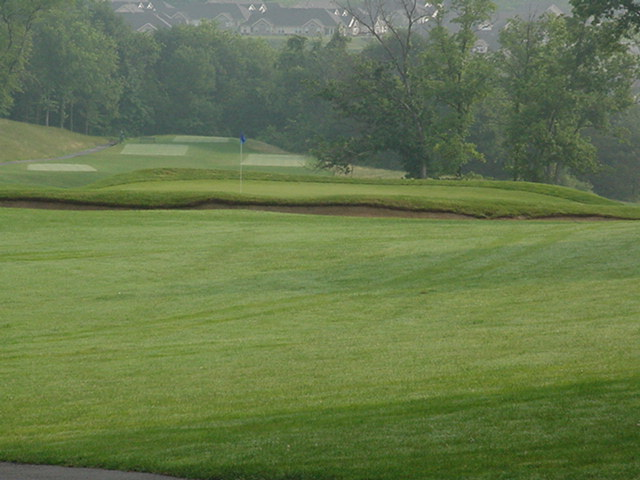 The bunker guarding the front of the second makes distance control a must.