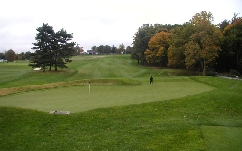 As seen from behind, the sixth at The Creek falls steeply downhill before reaching its one-of-a-kind manufactured punchbowl green.