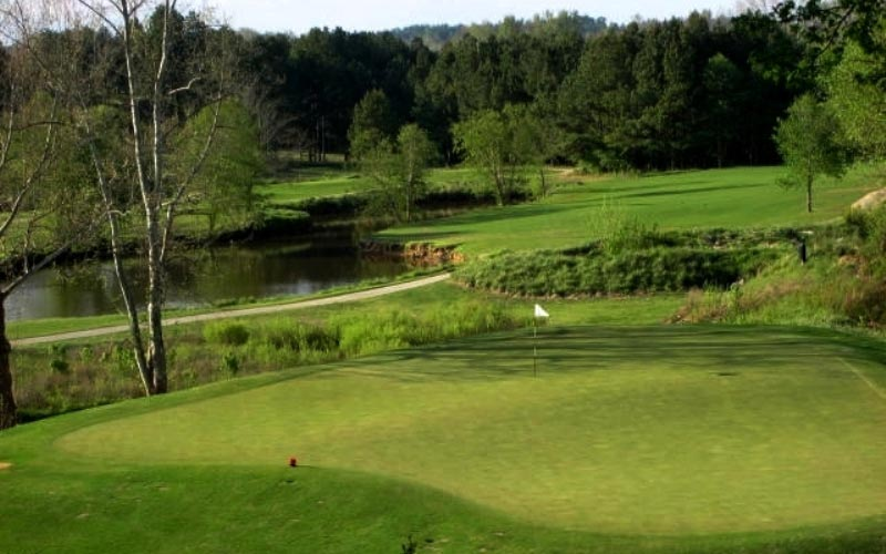 View of the seventh green from above left. The eighth fairway is in the background.