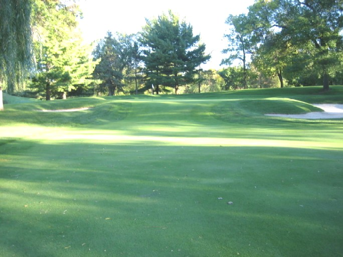 The 170 yard sixteenth from the forward tee. The back tee is to the right of this angle.