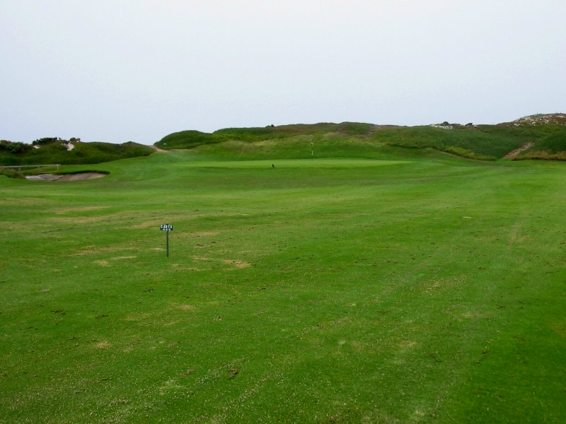 The 11th green is set at the base of the dunes.
