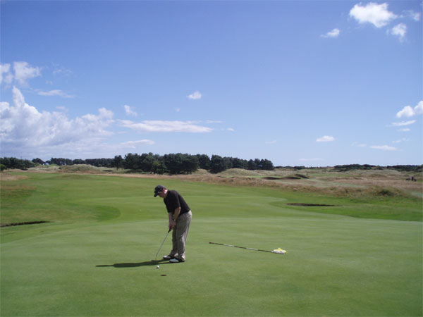 The author's brother putts on the par four tenth green.