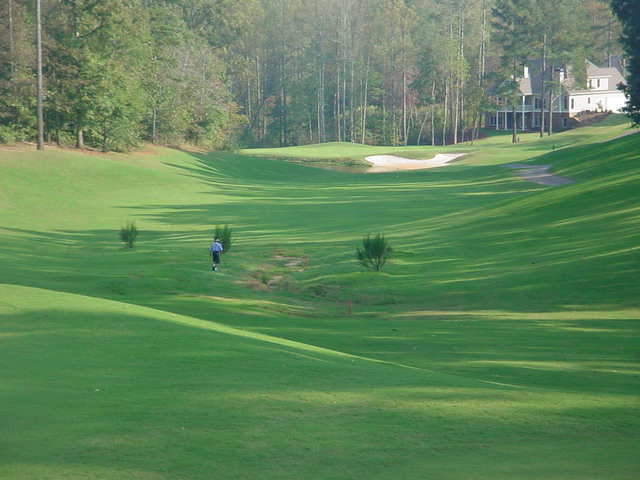 Notice how the hills on either side of the 3 hole kick the balls toward the fairway.