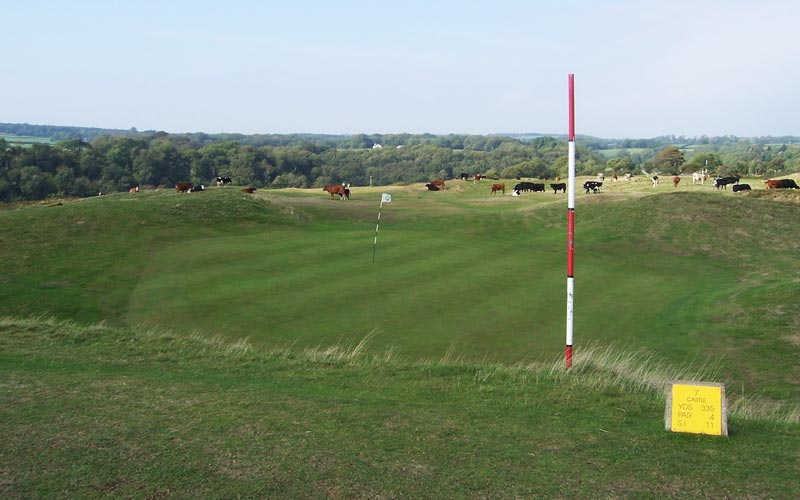 The raised-bowl sixth green viewed from the seventh tee.