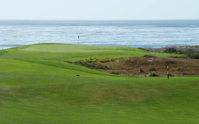 Though the environmentally sensitive areas undermine some of the fun, Spanish Bay is full of classic architectural features like this horizon green that calls for a nervy pitch at the first.