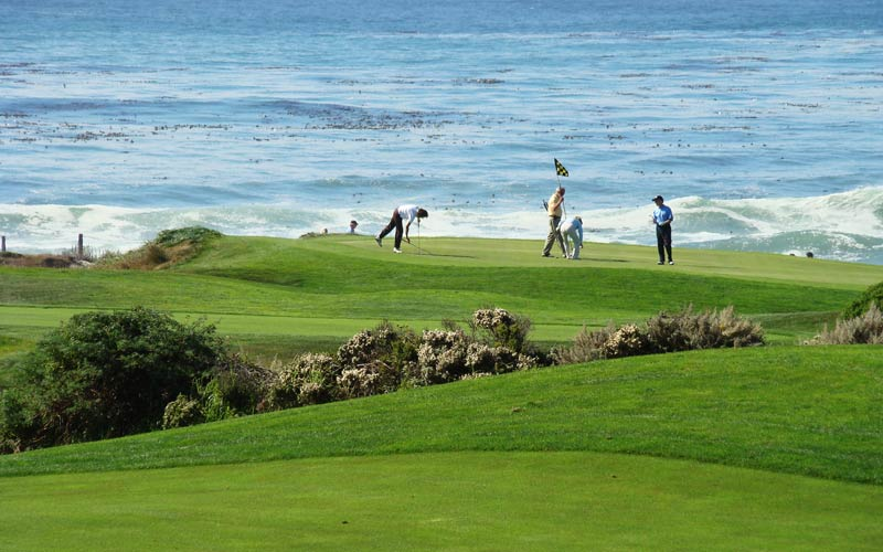The majestic setting of the seventeenth green at Spanish Bay, as seen from the Inn.