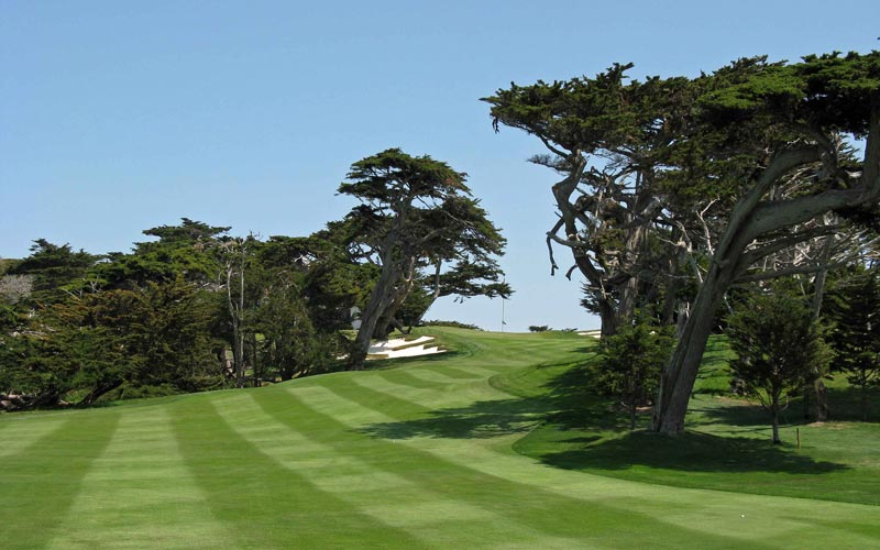 The eighteenth at Cypress Point Club is a short par four that doglegs right past cypress trees to an uphill green. Though not a typical finishing hole, it is by no means weak either.