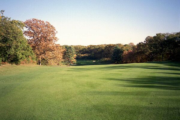 The green on the 16th is to the left of the bunker in the distance ¦ try keeping a ball in the middle of this fairway.