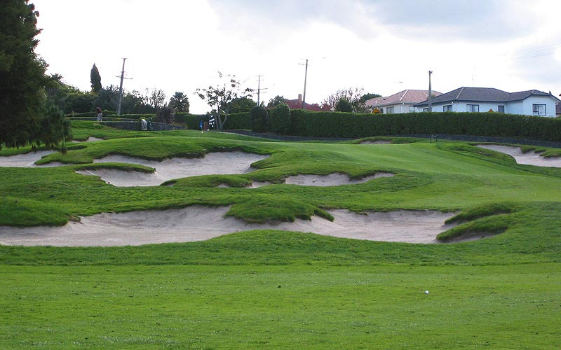 Bunkers on the inside of the dog-leg 18th hole, with the green just visible beyond.