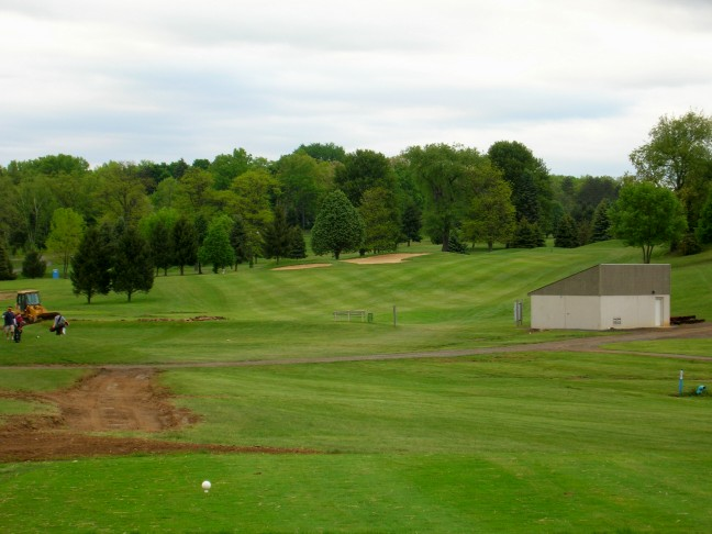 The ideal line off the new tee is at or slightly left of the bunkers. The trees to the left of the hole are slated to be removed by 2007.