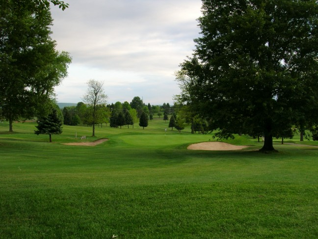 The push up ninth green from the right side of the fairway, showing the trouble a golfer can find with a sliced or pushed drive.