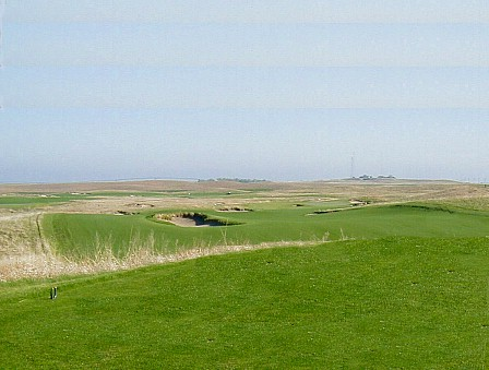The view from the middle tee with the top shot aiming bunker 150 yards out in the distance.
