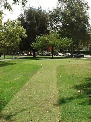 The fifth green at the Armand Hammer Golf Course, Los Angeles. A 60-yard shot, with O.B. to the right.