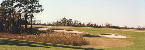 These bunkers determine the correct play for your second shot on the 14th.