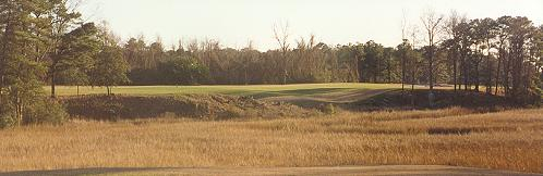 The tee shot across the tidal marsh on the fifteenth hole at Riverfront