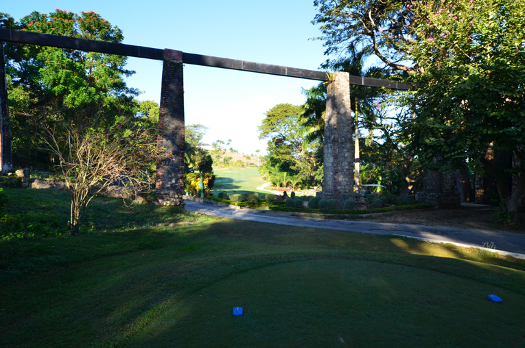 The tee ball from the back markers is played through the stone pillars of an aqueduct ....