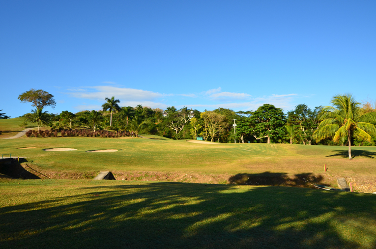 Plummer gracefully created a plateau atop a bed of coral for the 8th green, just over a creek bed. Note the perfect color of the fairway: overwatered, soft fairways are absent in Jamaica.