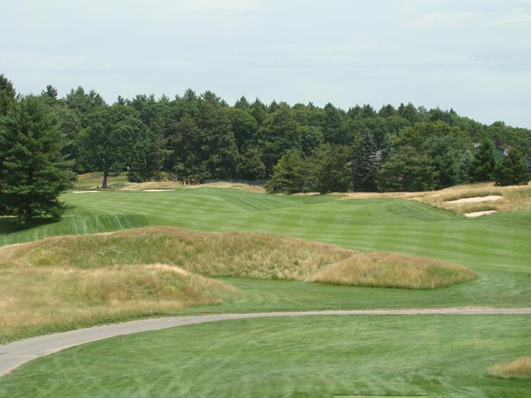 This unique horseshoe mound must be carried off the fourteenth tee.
