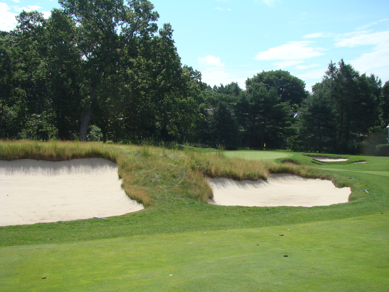 Hanse masterfully massaged the land to feed into these fairway bunkers.