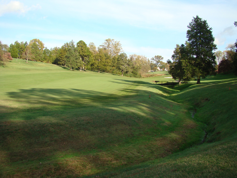 Just as it was advantageous on the last hole to hug the creek, so it also is at the fifth whose fairway bends to the right past this ditch. This is the number one handicap hole and those who steer too far left are unlikely to reach the green in regulation.