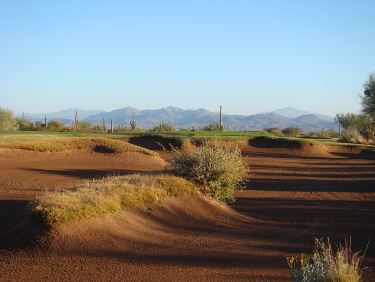 Drives on a direct line to the green must carry this handsome bunker.