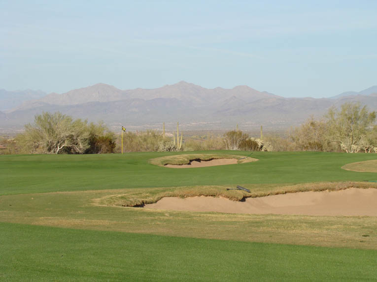 Note the clean lines around and behind the thirteenth green. The golfer is afforded yet another impressive long view.
