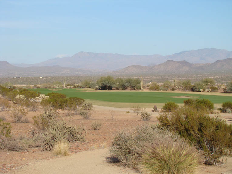 Look left and right at the desert floor and you gain an appreciation of how Coore & Crenshaw placed the fairway at grade to the desert floor.