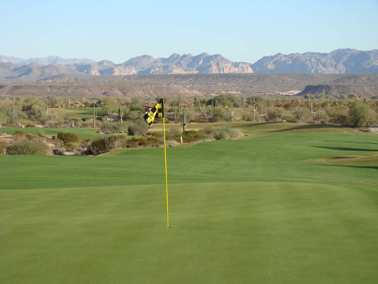 As seen from behind, the long broad sweep of the left fairway is evident above. So too is the fact that the right fairway provides the most direct route from tee to green.