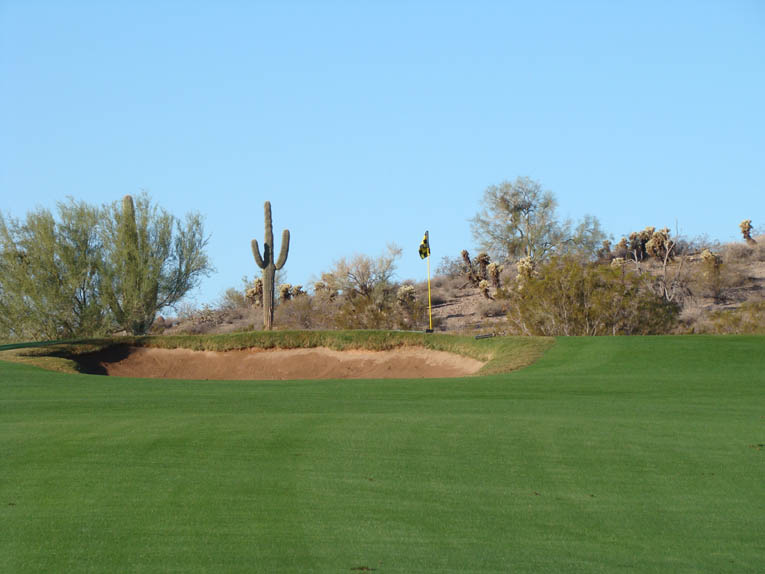 … leaving this unappealing pitch over a bunker to a putting surface that is out of sight.