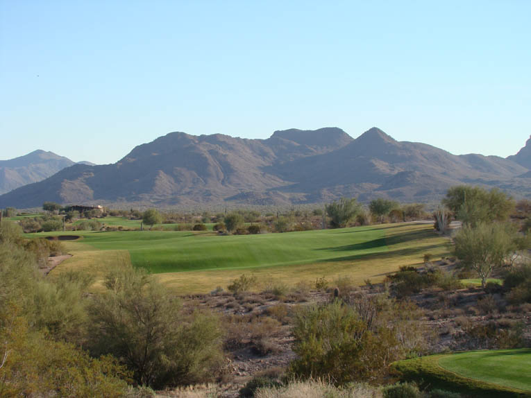 A fine plateau is offered 100 to 130 yards from the green. Anything closer and the golfer is likely to suffer either an awkward downhill stance or a poor view of the flag or both.