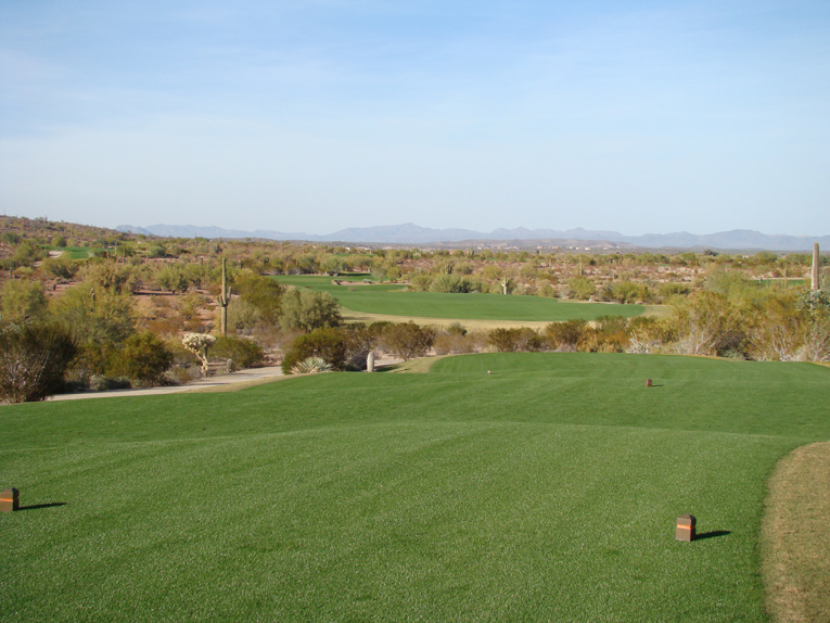 Unusual for the desert, note how the tee grounds roll down. This recurs at other elevated tees including the second, eighth, tenth, eleventh, fourteenth, fifteenth, seventeenth, and eighteenth.