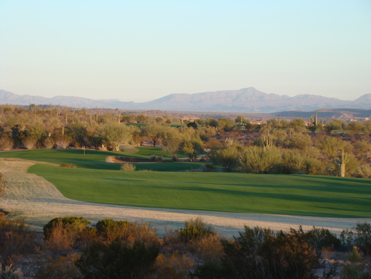 As seen in an early morning December light, the first fairway is vast, measuring over seventy yards from side to side. There is no reason to miss it which is good because ...