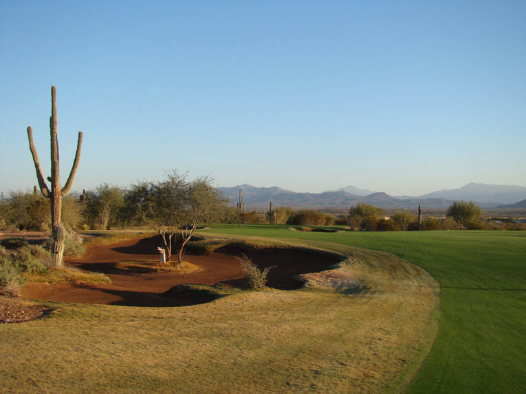 ... a formalized bunker that emerges from the desert floor. The bunker sand was dredged from the nearby Verde River and washed to meet We-Ko-Pa's specifications.