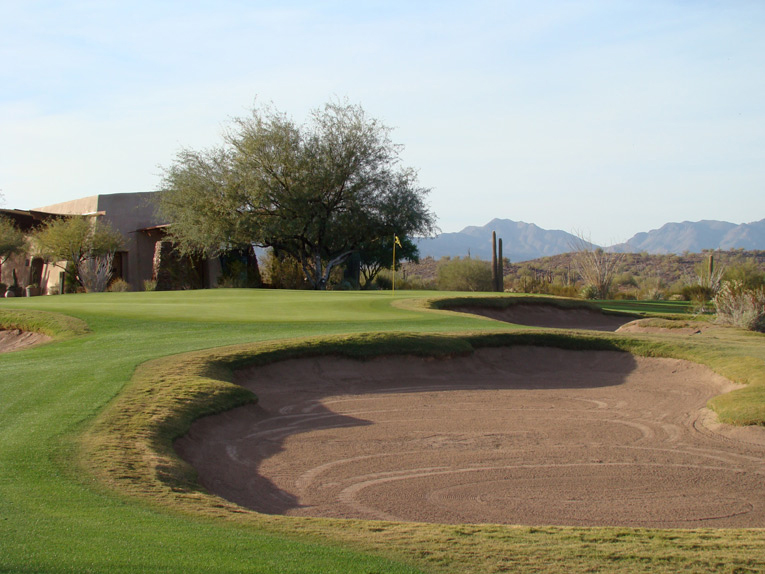 Cross winds, the kidney shaped green that bends right around the far bunker above, and the narrowness of the putting surface help make the ninth a testy proposition.