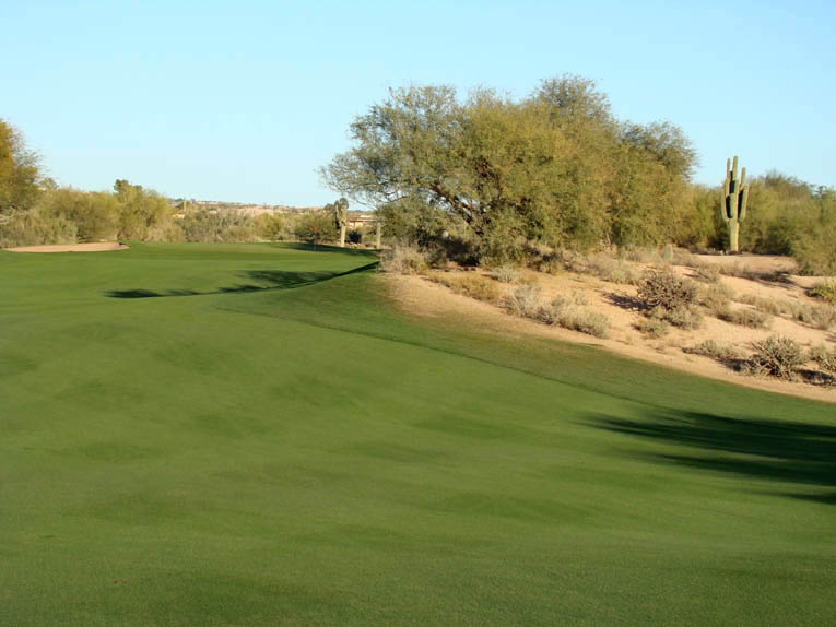 A straight 225 yard tee ball finishes in the shadow area of the fairway but leaves a long difficult approach. Can the golfer fit his tee ball farther left? Though not evident from tee, the left fairway slot is ...