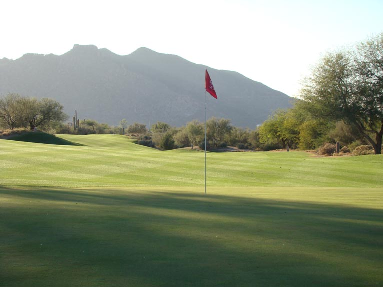 ... ample in width as captured in this view from behind the green.
