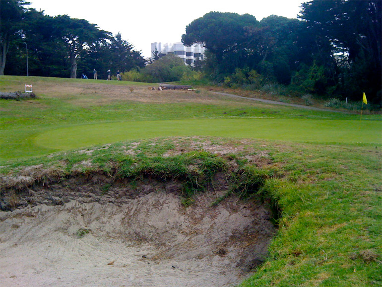 The green on the 4th hole, with the 5th tee up the hill in the background.