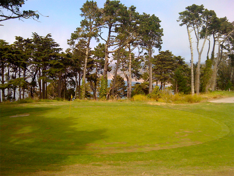 The 15th green from the left side, with Baker Beach in the background.