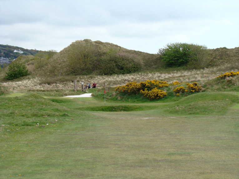 A real charmer, the green is snuggled low between dunes. Ideally, every links would have such a short hole where the ability to flight the ball through the wind is paramount.