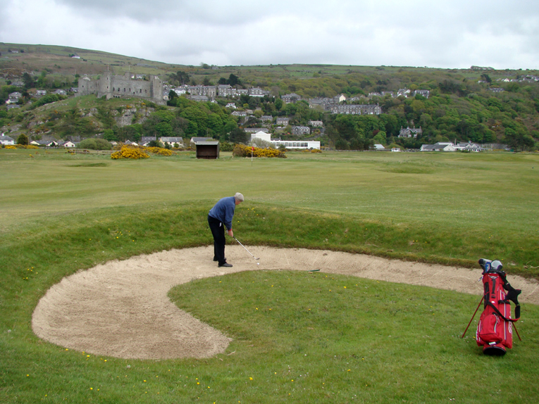 Old, established courses have a way of featuring unusual hazards. This imaginative bunker fifty yards short of the twelfth green is one such example at Harlech.