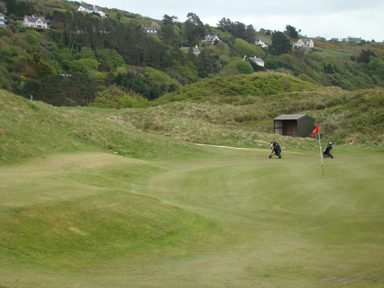 Tucked into the dunes, there are many ways to use the surrounding ground to approach this green.