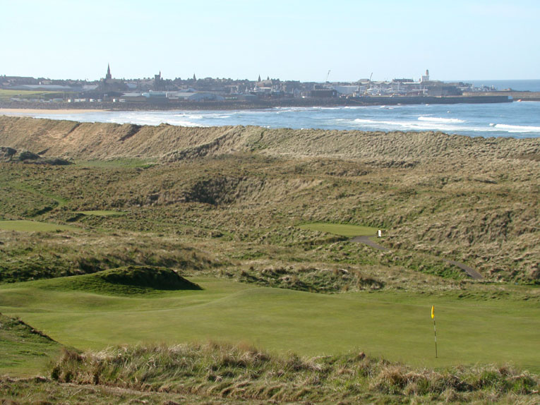 What a view looking back across the second green out toward Fraserburgh and Inverallochy! One of the hole's big fairway mounds is prominent left of the green.